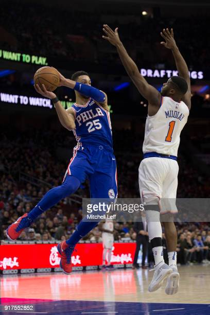 Ben Simmons of the Philadelphia 76ers passes the ball against Emmanuel Mudiay of the New York Knicks in the first quarter at the Wells Fargo Center...
