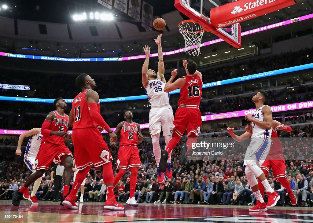 Ben Simmons #25 of the Philadelphia 76ers puts up a shot against Paul Zipser #16 of the Chicago Bulls at the United Center on December 18, 2017 in Chicago, Illinois. The Bulls defeated the 76ers 117-115.