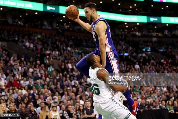 Ben Simmons of the Philadelphia 76ers runs into Marcus Smart of the Boston Celtics during the third quarter at TD Garden on November 30 2017 in...