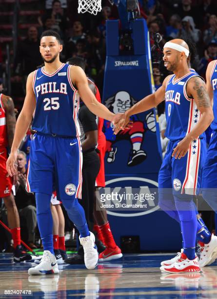 Ben Simmons of the Philadelphia 76ers shakes hands with Jerryd Bayless against the Washington Wizards at Wells Fargo Center on November 29 2017 in...