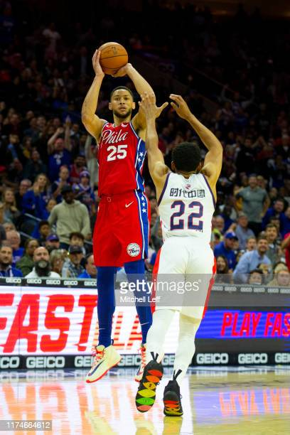 Ben Simmons of the Philadelphia 76ers shoots a three point shot against CJ Harris of the Guangzhou LongLions in the second quarter during the...