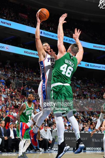 Ben Simmons of the Philadelphia 76ers shoots the ball against Aron Baynes of the Boston Celtics during a preseason on October 6 2017 at Wells Fargo...