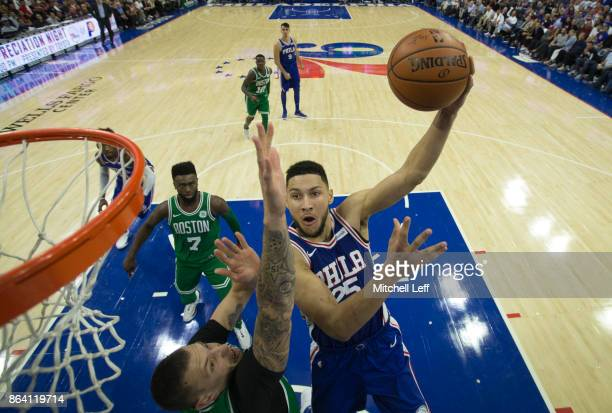 Ben Simmons of the Philadelphia 76ers shoots the ball against Daniel Theis of the Boston Celtics in the fourth quarter at the Wells Fargo Center on...