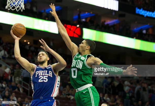 Ben Simmons of the Philadelphia 76ers shoots the ball against Jayson Tatum of the Boston Celtics at the Wells Fargo Center on October 20 2017 in...