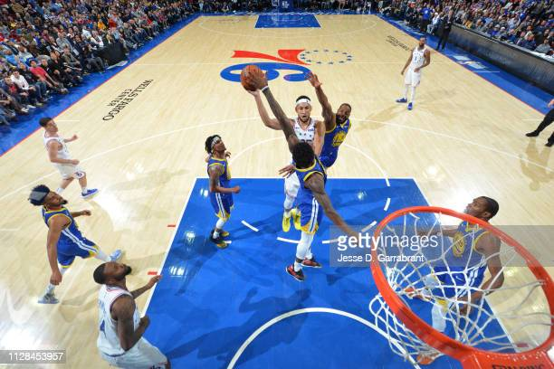 Ben Simmons of the Philadelphia 76ers shoots the ball against the Golden State Warriors on March 2 2019 at the Wells Fargo Center in Philadelphia...
