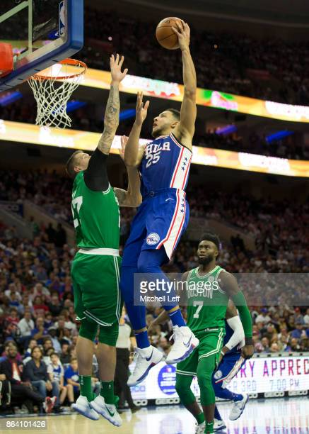 Ben Simmons of the Philadelphia 76ers shoots the ball against the ball against Daniel Theis of the Boston Celtics in the fourth quarter at the Wells...