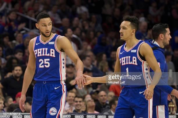 Ben Simmons of the Philadelphia 76ers slaps hands with Landry Shamet against the New Orleans Pelicans at the Wells Fargo Center on November 21 2018...