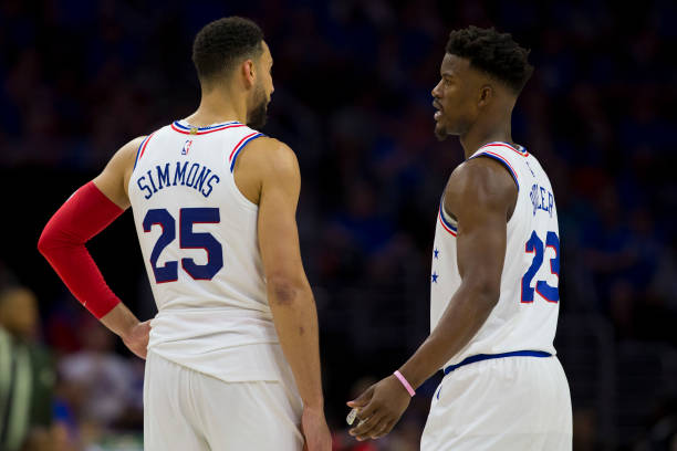 Ben Simmons of the Philadelphia 76ers talks to Jimmy Butler against the Toronto Raptors in Game Three of the Eastern Conference Semifinals at the...
