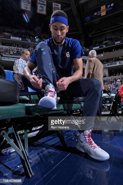 Ben Simmons of the Philadelphia 76ers ties his sneakers before the game against the Indiana Pacers on January 17 2019 at Bankers Life Fieldhouse in...