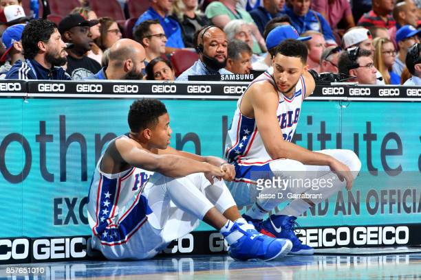 Ben Simmons talks with Markelle Fultz of the Philadelphia 76ers during the game against the Memphis Grizzlies during a preseason game on October 4...