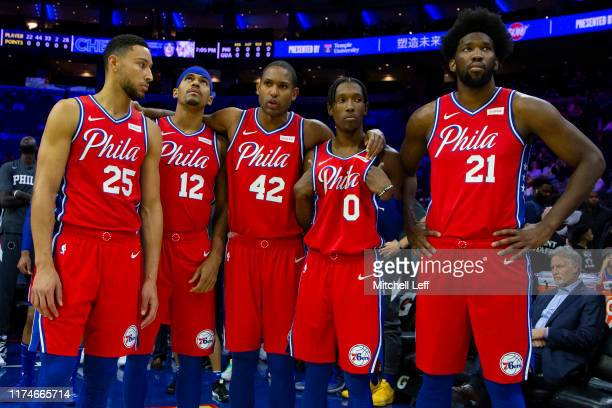 Ben Simmons Tobias Harris Al Horford Josh Richardson and Joel Embiid of the Philadelphia 76ers look on prior to the start of the preseason game...