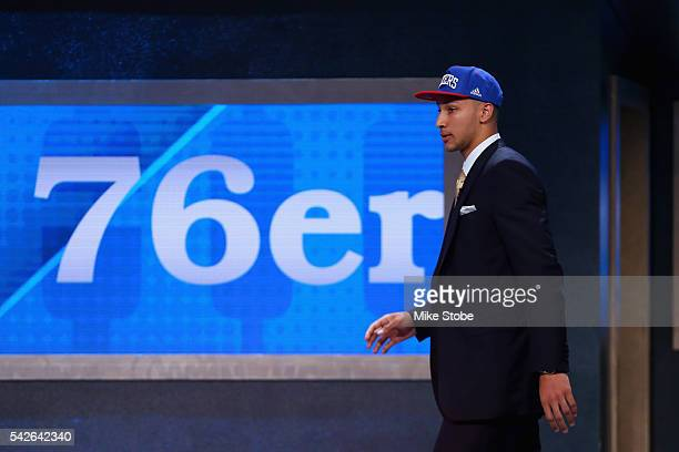 Ben Simmons walks on stage after being drafted first overall by the Philadelphia 76ers in the first round of the 2016 NBA Draft at the Barclays...