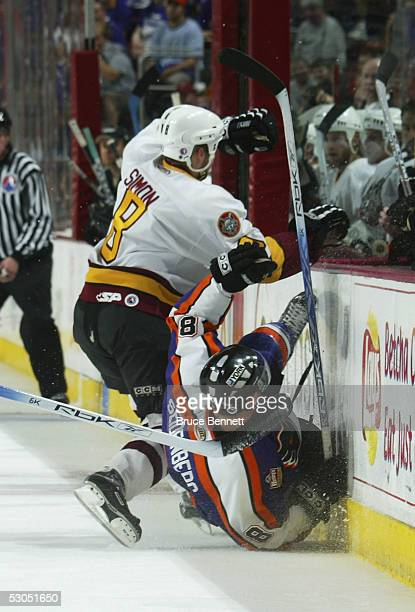 Ben Simon of the Chicago Wolves boards Dennis Seidenberg of the Philadelphia Phantoms during the American Hockey League Calder Cup final game at the...