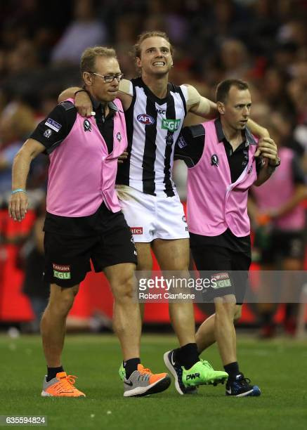 Ben Sinclair of the Magpies come off the ground with an injury during the 2017 JLT Community Series match between the Collingwood Magpies and...