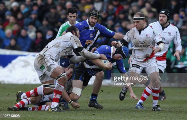 Ben Skirving of Bath is tackled during the Heineken Cup pool 4 match between Bath and Ulster at the Recreation Ground on December 18, 2010 in Bath,...