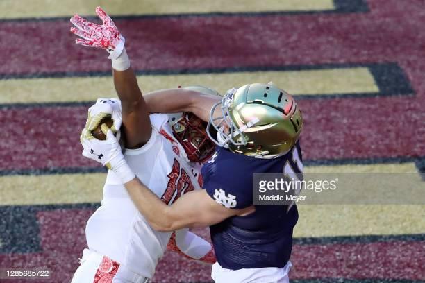 Ben Skowronek of the Notre Dame Fighting Irish catches a touchdown pass over Brandon Sebastian of the Boston College Eagles at Alumni Stadium on...