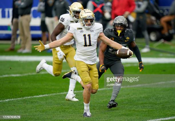 Ben Skowronek of the Notre Dame Fighting Irish reacts as he runs towards the end zone for a 34yard touchdown reception in the first quarter during...
