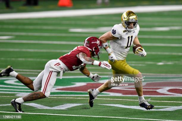 Ben Skowronek of the Notre Dame Fighting Irish runs with the ball against Brian Branch of the Alabama Crimson Tide during the College Football...
