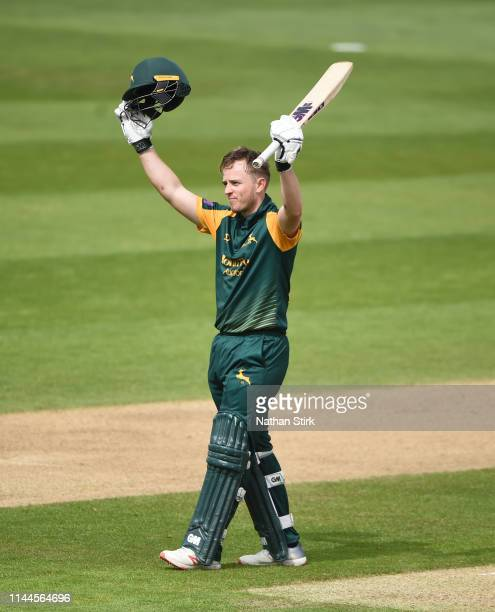 Ben Slater of Nottingham raises his bat after scoring 100 runs during the Royal London One Day Cup match between Warwickshire and Nottinghamshire at...