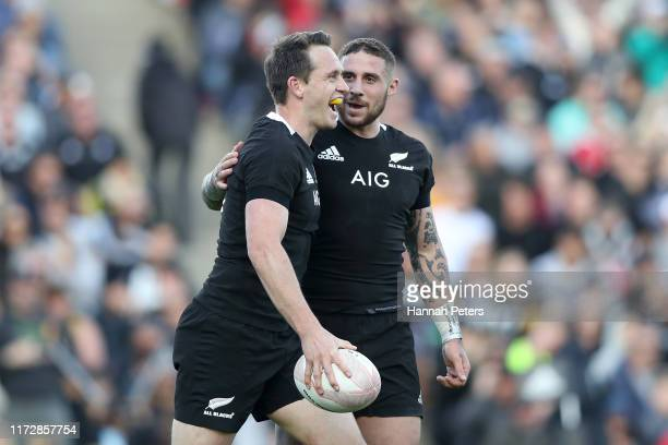 Ben Smith and TJ Perenara of the All Blacks celebrate after scoring a try during the rugby Test Match between the New Zealand All Blacks and Tonga at...