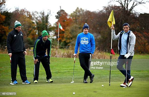 Ben Smith Cory Jane Beauden Barrett and TJ Perenara look on as some of the New Zealand All Blacks enjoy a round of golf on their day off at the...