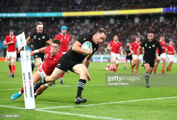 Ben Smith of New Zealand breaks through to score his team's fourth try during the Rugby World Cup 2019 Bronze Final match between New Zealand and...