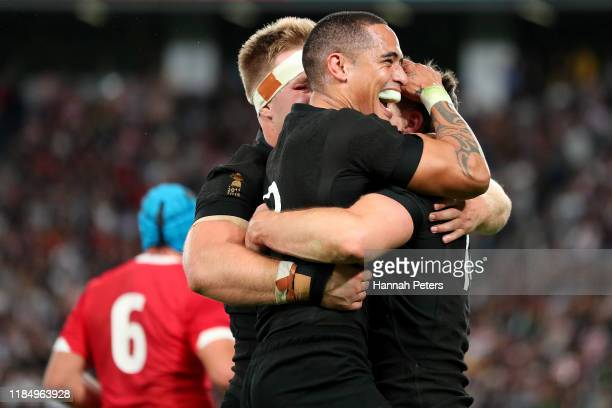 Ben Smith of New Zealand celebrates with Sam Cane and Aaron Smith after scoring a try during the Rugby World Cup 2019 Bronze Final match between New...