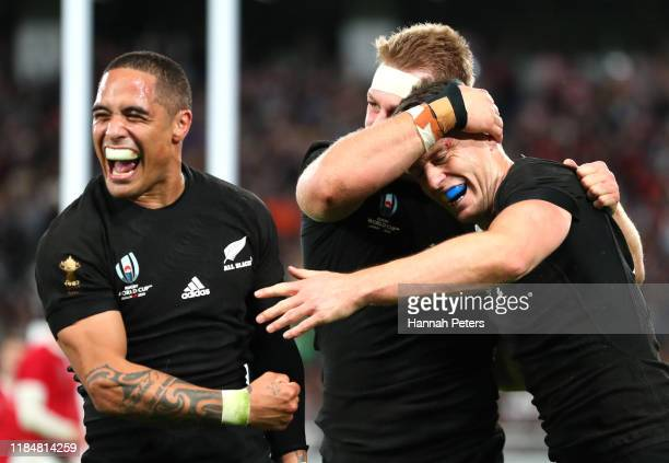 Ben Smith of New Zealand celebrates with Sam Cane and Aaron Smith as he scores his team's fourth try during the Rugby World Cup 2019 Bronze Final...