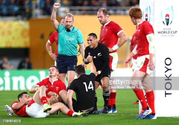 Ben Smith of New Zealand celebrates with teammate Aaron Smith after scoring his team's third try during the Rugby World Cup 2019 Bronze Final match...