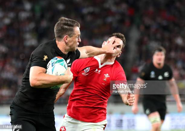 Ben Smith of New Zealand hands off Tomos Williams of Wales as he scores his team's fourth try during the Rugby World Cup 2019 Bronze Final match...