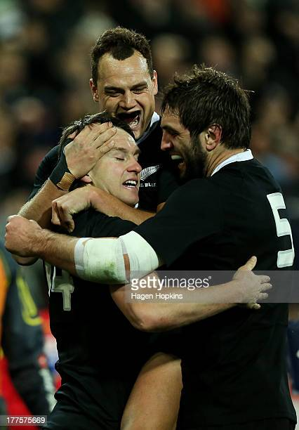 Ben Smith of New Zealand is congratulated on his try by teammates Israel Dagg and Sam Whitelock during The Rugby Championship Bledisloe Cup match...