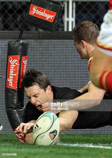 Ben Smith of New Zealand scores a try during the International Test match between the New Zealand All Blacks and Wales at Forsyth Barr Stadium on...
