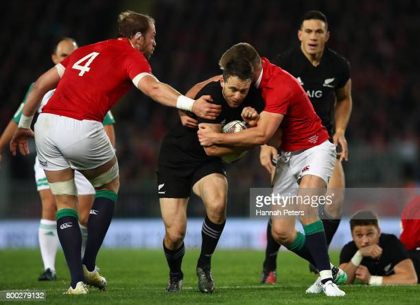 Ben Smith of the All Blacks is tackled by Alun Wyn Jones of the Lions and Owen Farrell of the Lions during the first test match between the New...