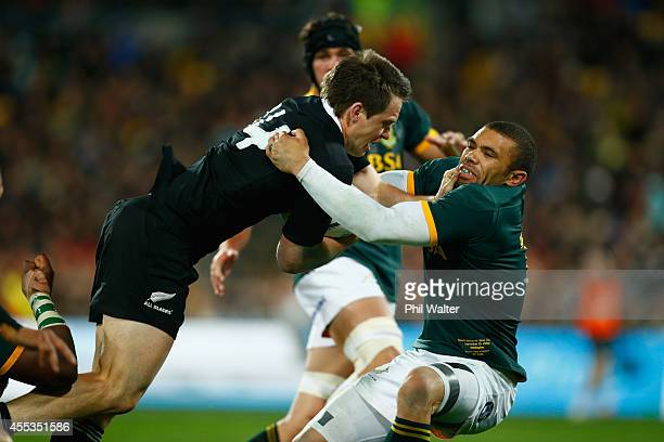 Ben Smith of the All Blacks is tackled by Bryan Habana of the Springboks during The Rugby Championship match between the New Zealand All Blacks and...