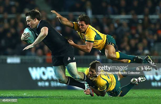 Ben Smith of The All Blacks is tackled by Nick Phipps and Bernard Foley of The Wallabies during The Rugby Championship match between the New Zealand...