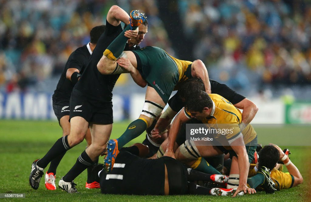 Ben Smith of the All Blacks lifts Scott Fardy of the Wallabies off the ball during The Rugby Championship match between the Australian Wallabies and the New Zealand All Blacks at ANZ Stadium on August 16, 2014 in Sydney, Australia.