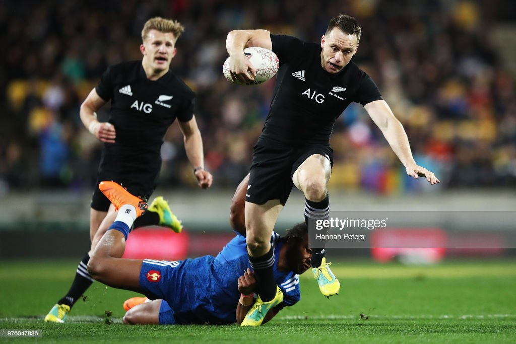 Ben Smith of the All Blacks makes a break during the International Test match between the New Zealand All Blacks and France at Westpac Stadium on June 16, 2018 in Wellington, New Zealand.