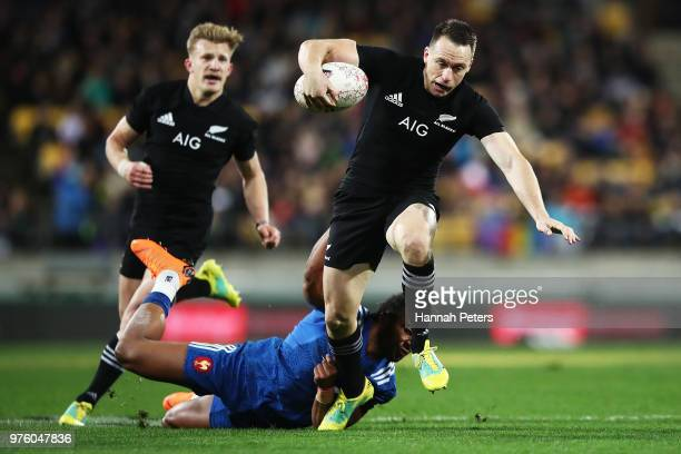 Ben Smith of the All Blacks makes a break during the International Test match between the New Zealand All Blacks and France at Westpac Stadium on...