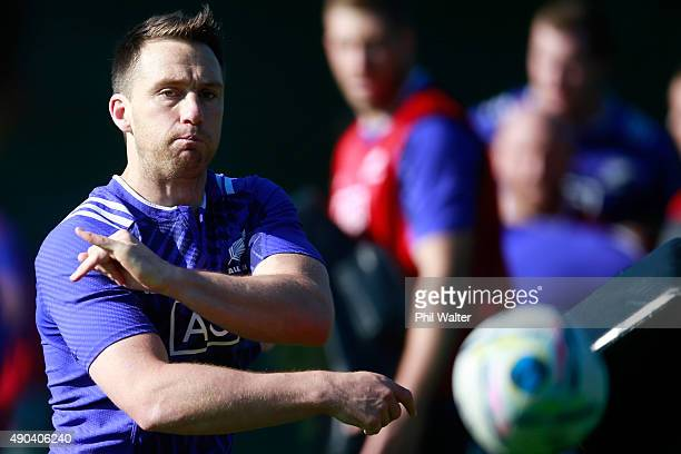 Ben Smith of the All Blacks passes during a New Zealand All Blacks training session at Sophia Gardens on September 28, 2015 in Cardiff, United...