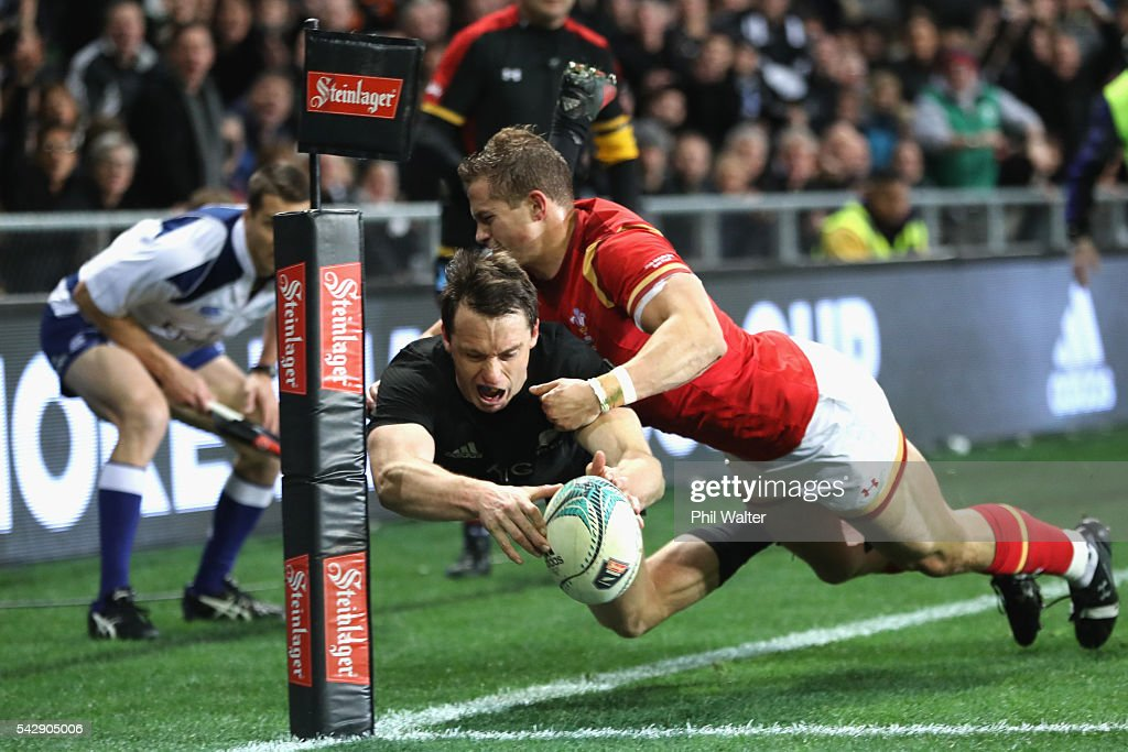 Ben Smith of the All Blacks scores a try in the tackle of Hallam Amos of Wales during the International Test match between the New Zealand All Blacks and Wales at Forsyth Barr Stadium on June 25, 2016 in Dunedin, New Zealand.