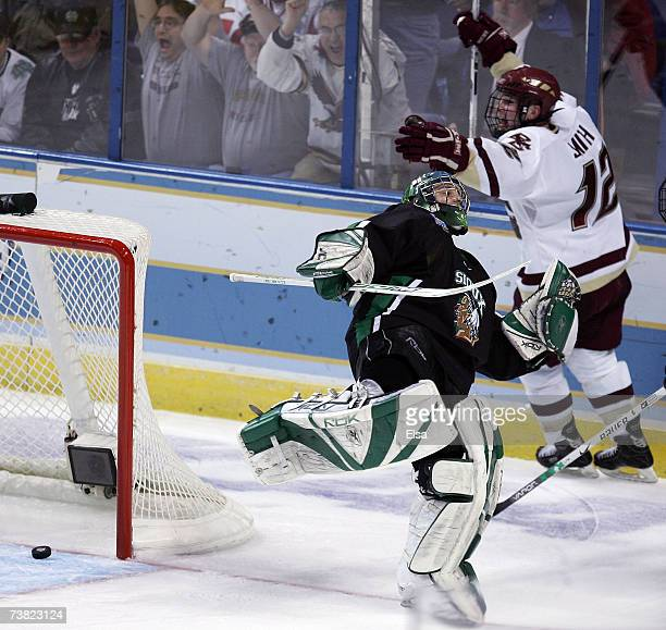Ben Smith of the Boston College Eagles celebrates his goal as Jean-Philippe Lamoureux of the North Dakota Fighting stumbles during the Division I...