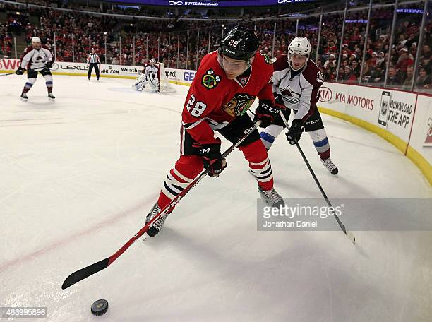 Ben Smith of the Chicago Blackhawks controls the puck in the corner next to Matt Duchene of the Colorado Avalanche at the United Center on February...
