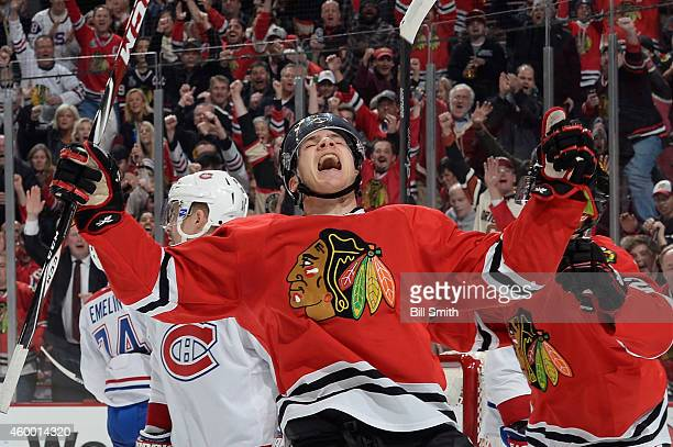 Ben Smith of the Chicago Blackhawks reacts after scoring against the Montreal Canadiens in the first period during the NHL game at the United Center...