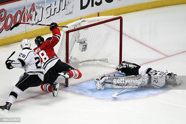 Ben Smith of the Chicago Blackhawks scores a goal on Jonathan Quick of the Los Angeles Kings to tie the game in the third period during Game Five of...
