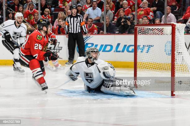 Ben Smith of the Chicago Blackhawks scores on goalie Jonathan Quick of the Los Angeles Kings in the third period in Game Five of the Western...