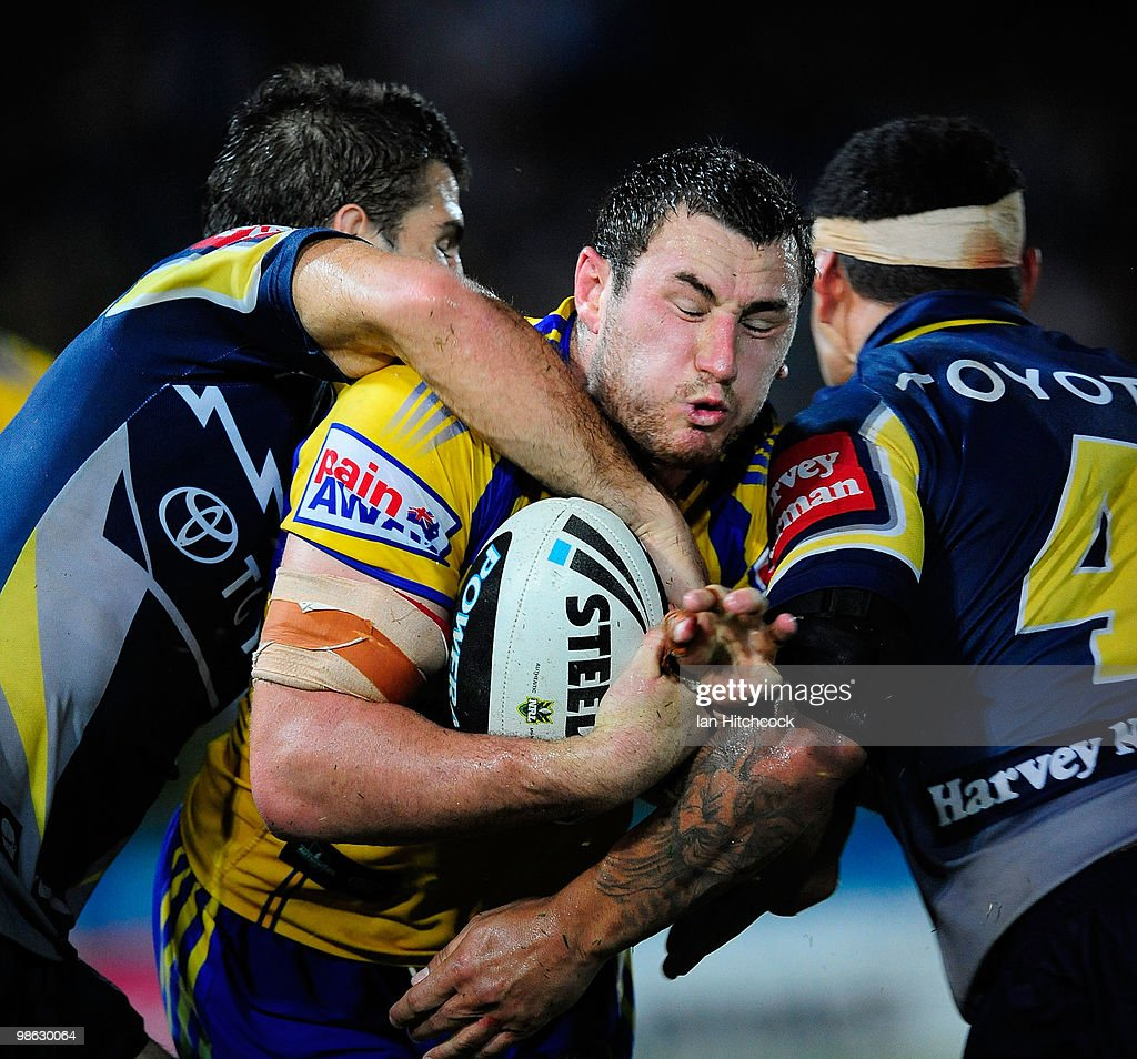 Ben Smith of the Eels is tackled by Willie Tonga and John Williams of the Cowboys during the round seven NRL match between the North Queensland Cowboys and the Parramatta Eels at Dairy Farmers Stadium on April 23, 2010 in Townsville, Australia.