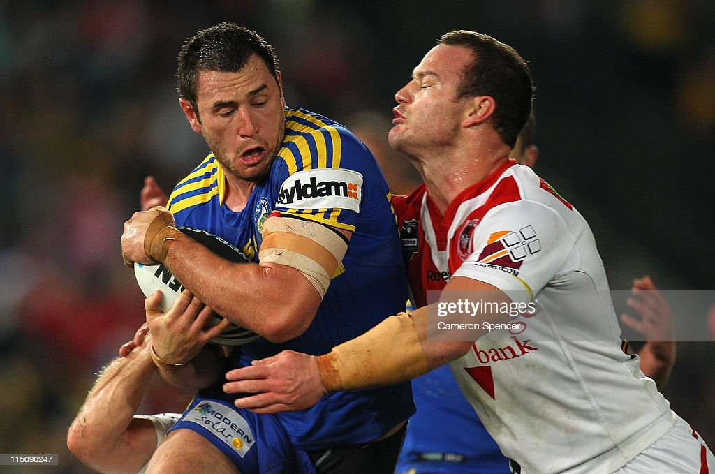 Ben Smith of the Eels is tackled during the round 13 NRL match between the Parramatta Eels and the St George Illawarra Dragons at Parramatta Stadium on June 3, 2011 in Sydney, Australia.