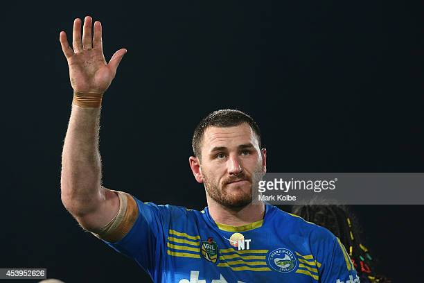 Ben Smith of the Eels waves to the crowd as he is farewelled from the club on field after the round 24 NRL match between the Parramatta Eels and the...