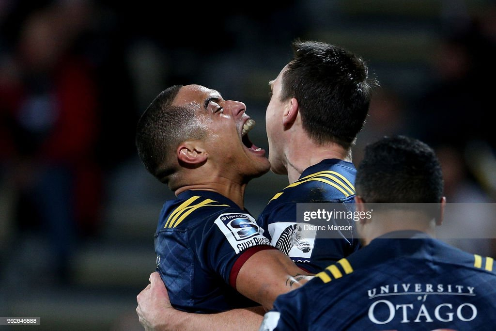 Ben Smith (R) of the Highlanders celebrates his try with team-mate Aaron Smith during the round 18 Super Rugby match between the Crusaders and the Highlanders at AMI Stadium on July 6, 2018 in Christchurch, New Zealand.