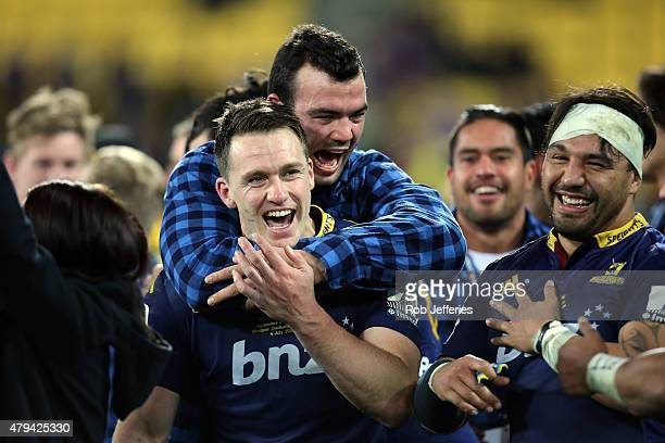 Ben Smith of the Highlanders celebrates victory with Tom Franklin and Ash Dixon during the Super Rugby Final match between the Hurricanes and the...